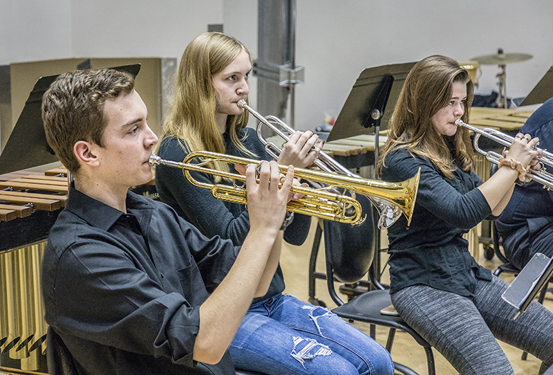 Three trumpet players